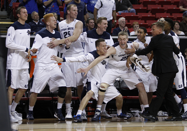 Utah State players celebrate as their team comes within one point of Colorado State during the first round of the Mountain West Championships tournament at the Thomas & Mack Center in Las Vegas We ...