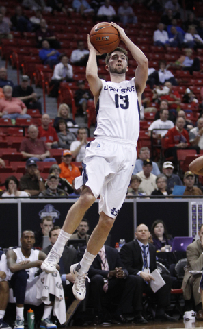 Preston Medlin of Utah State makes a rebound during the first round of the Mountain West Championships tournament at the Thomas & Mack Center in Las Vegas Wednesday, March 12, 2014. (John Locher/L ...