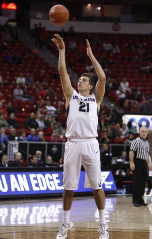 Utah State player Spencer Butterfield sinks a free throw to bring his team ahead of Colorado State during the first round of the Mountain West Championships tournament at the Thomas & Mack Center  ...