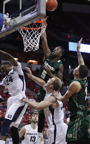 Jon Octeus of Colorado State goes up for a shot against Utah State during the first round of the Mountain West Championships tournament at the Thomas & Mack Center in Las Vegas Wednesday, March 12 ...