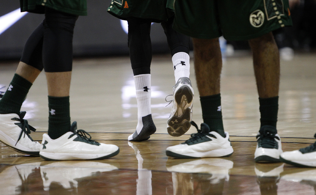 A Colorado State player loses his shoe during the first round of the Mountain West Championships tournament at the Thomas & Mack Center in Las Vegas Wednesday, March 12, 2014. (John Locher/Las Veg ...