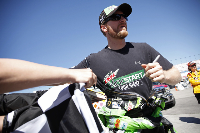 Dale Earnhardt Jr. signs autographs at the Las Vegas Motor Speedway during NASCAR Spring Cup Series KOBALT 400 practice Saturday, March 8, 2014. (John Locher/Las Vegas Review-Journal)