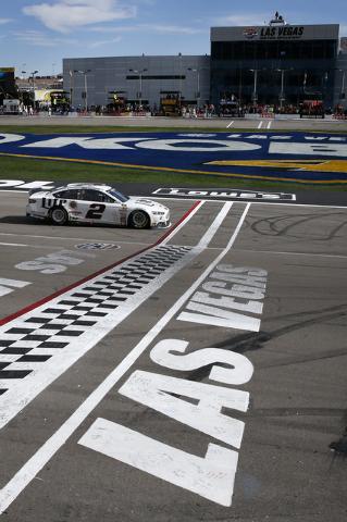 Brad Keselowski (2) takes a victory lap after winning the NASCAR Kobalt 400 at the Las Vegas Motor Speedway in Las Vegas Sunday, March 9, 2014. (John Locher/Las Vegas Review-Journal)