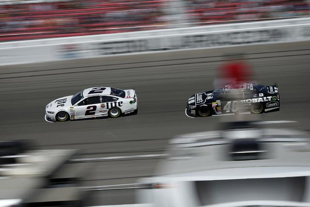 Brad Keselowski (2) and Jimmie Johnson (48) race during the NASCAR Kobalt 400 at the Las Vegas Motor Speedway in Las Vegas Sunday, March 9, 2014. (John Locher/Las Vegas Review-Journal)