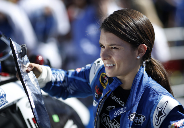 Danica Patrick (10) prepares to get into her car before the start of the NASCAR Kobalt 400 at the Las Vegas Motor Speedway in Las Vegas Sunday, March 9, 2014. (John Locher/Las Vegas Review-Journal)