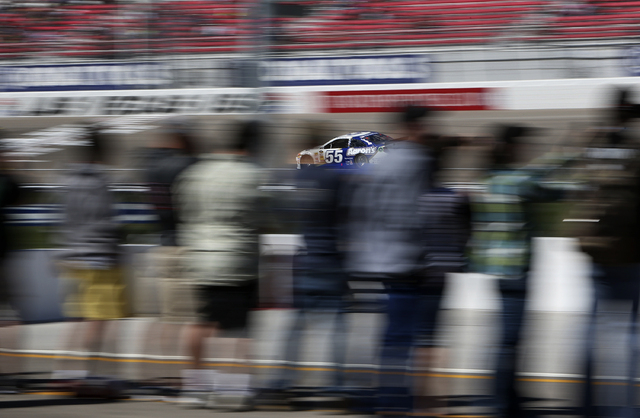 Brian Vickers (55) races around the Las Vegas Motor Speedway during the NASCAR Sprint Cup Series Kobalt 400 practice Saturday. (John Locher/Las Vegas Review-Journal)