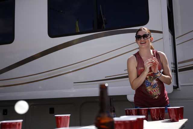 Paulina Meriwether plays beer pong, one of the many activities to be found in the infield of the speedway during the NASCAR Kobalt 400. (John Locher/Las Vegas Review-Journal)