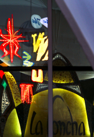 A neon sign reflects of the window Oct. 17, 2012 of the La Concha Motel at The Neon Museum at 770 Las Vegas Boulevard. (Jeff Scheid/Las Vegas Review-Journal)
