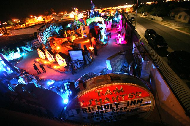 People walk through the Neon Museum at 770 Las Vegas Boulevard during the Grand Lighting ceremony Tuesday, Oct. 23, 2012. In 2013, the first full year of operation, the museum and the Neon Boneyar ...