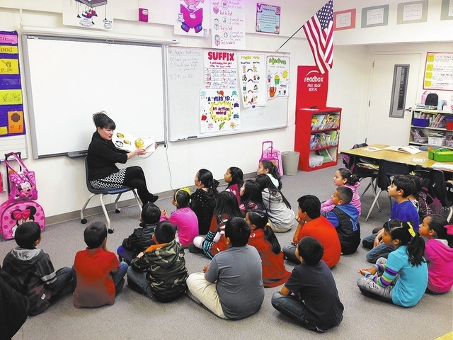 Special to View Brooke Thompson with Bank of America reads to a class March 4 at Fay Herron Elementary School, 2421 Kenneth Road, during Nevada Reading Week.