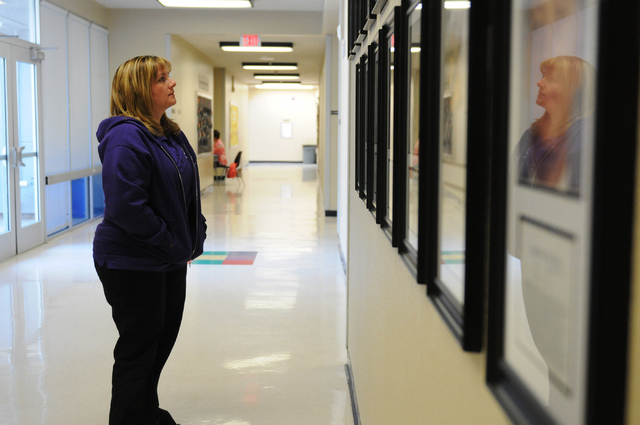 Bridget Leatherman, principal at May Elementary School in Las Vegas, looks at a wall dedicated to Clark County police officers who have died in the line of duty Friday, Feb. 21, 2014. The memorial ...
