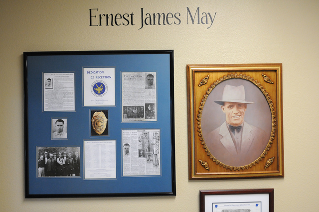 A framed piece dedicated to Ernest J. May, the first Las Vegas police officer to die in the line of duty, is seen at May Elementary School in Las Vegas Friday, Feb. 21, 2014. (Erik Verduzco/Las Ve ...