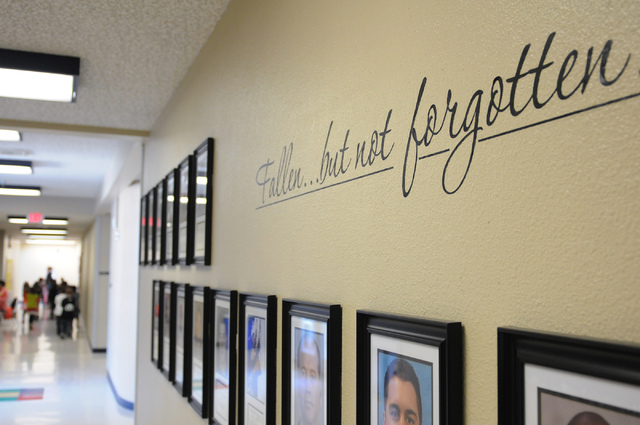 Clark County police officers who have died in the line of duty are honored with their photographs and biographies in a wall at the entrance to May Elementary School in Las Vegas Friday, Feb. 21, 2 ...