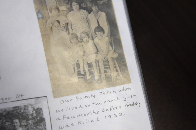 Bridget Leatherman, principal at May Elementary School in Las Vegas, shows a photo album with photos of Ernest J. May and his family Friday, Feb. 21, 2014. May is the first Las Vegas police office ...