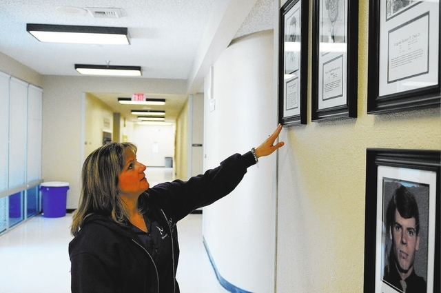 Bridget Leatherman, principal at May Elementary School in Las Vegas, points to a photo of Ernest J. May, the first Las Vegas police officer to die in the line of duty and who the school's name is  ...
