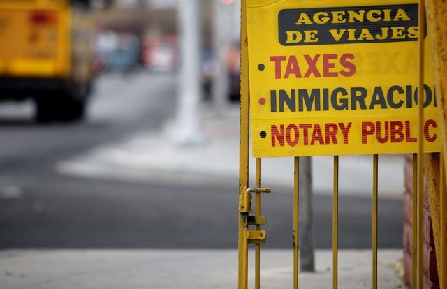 Notary public services are advertised at a business in Las Vegas that caters to Spanish speakers on Thursday, July 11, 2013. Notary publics who prepare documents for undocumented workers here in N ...