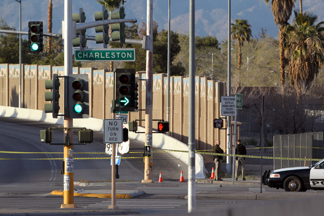 Las Vegas police investigate the scene of an officer-involved shooting at the onramp to north onramp to U.S. Highway 95 at Charleston Boulevard Monday, March 3, 2014. Officers were investigating a ...