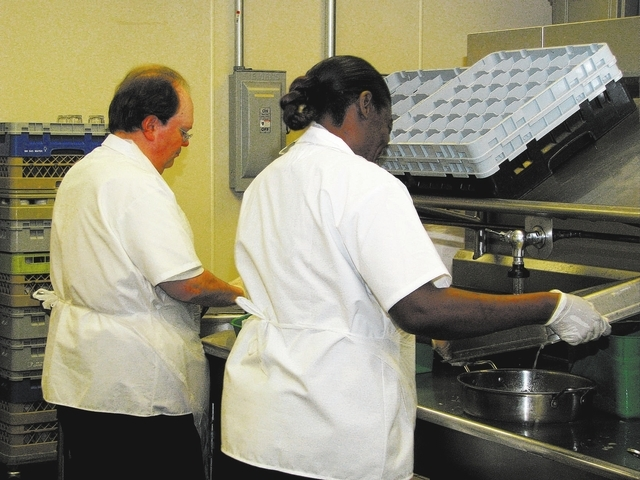Gordon Crisp and Crystal Jones, clients with Catholic Charities of Southern Nevada, train Feb. 17 to be a kitchen stewards at the Culinary Academy of Las Vegas, 710 W. Lake Mead Blvd. (F. Andrew T ...