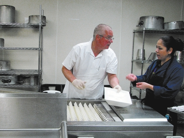 Gary Lilly, a client with Catholic Charities of Southern Nevada, trains to be a kitchen steward Feb. 17 with the help of Avelia Denniz, a staff steward at the Culinary Academy of Las Vegas. (F. An ...