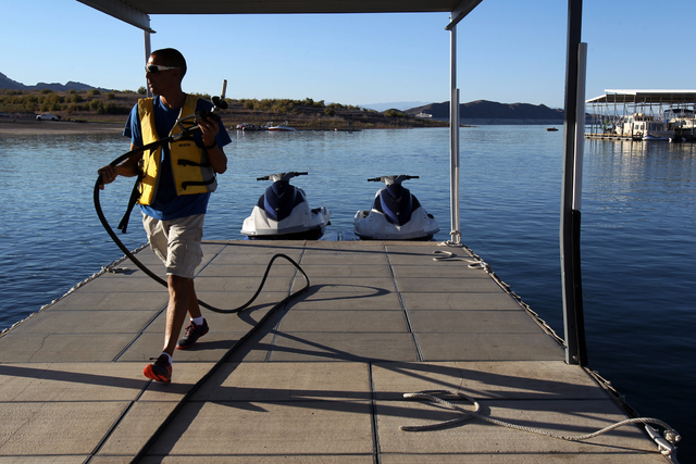 Andy Cassels refuels watercraft at Las Vegas Boat harbor on Lake Mead Thursday, Oct. 18, 2013, the first day the national recreation area opened after the partial government shutdown. (K.M. Cannon ...