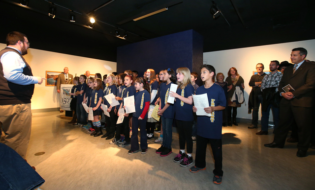 Gov. Brian Sandoval, far right, was among nearly 500 people who watched the Fremont Singers, from Fremont Elementary School in Carson City, sing Home Means Nevada at the grand opening event for th ...