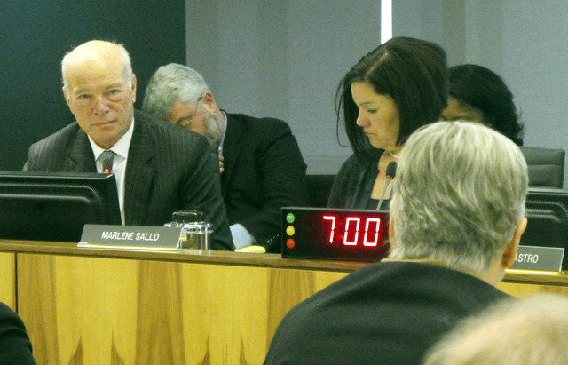 """David Kladney, left, a Reno attorney and member of the U.S. Commission on Civil Rights, listens to a witness at a commission hearing on """"patient dumping,"""" Friday, March 14, 2014. (Ph ..."""