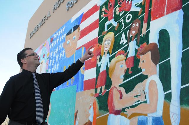 David Hudzick, principal at Piggott Elementary School, 9601 Red Hills Road, stands in front of the school's mural dedicated to the life of school namesake Clarence A. Piggott, Feb. 20. Piggott was ...