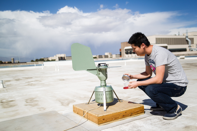 UNLV graduate student Hongbin Jin checks a pollen monitoring machine which collects samples on the roof of the White Life Sciences building on the campus of the University of Nevada, Las Vegas on  ...
