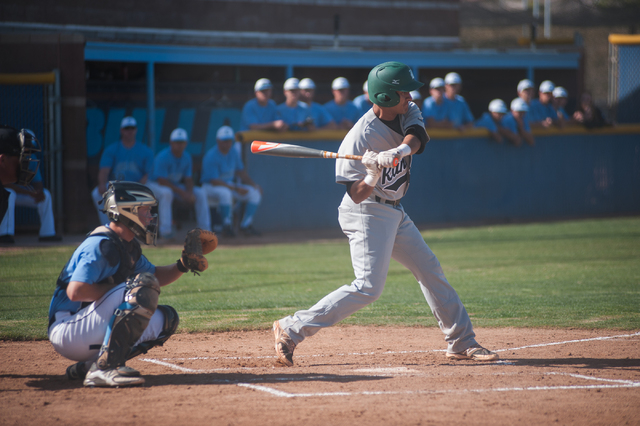 Rancho senior Jose Verdugo swings at a pitch against Centennial on Friday. Verdugo had a double and a two-run homer. (Martin S. Fuentes/Las Vegas Review-Journal)