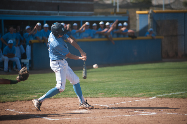 Centennial High School freshman Kyle Horton swings at a pitch against Rancho on Friday. (Martin S. Fuentes/Las Vegas Review-Journal)