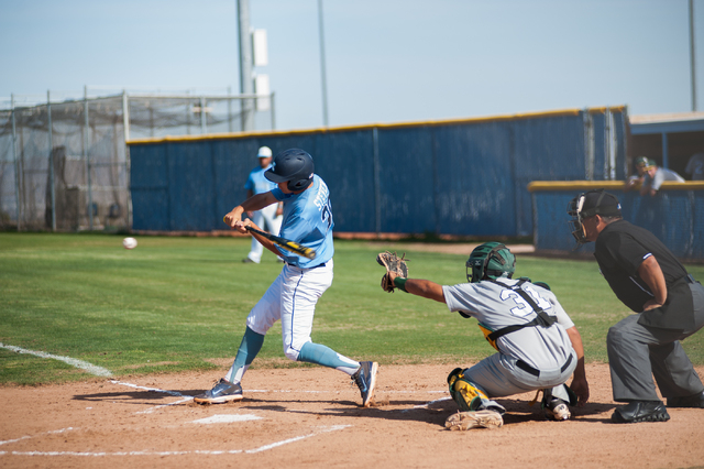 Centennial  junior Travis Stevens swings at a pitch against Rancho on Friday. Stevens drove in two runs, and every Centennial starter had a hit in an 11-7 win over the Rams. (Martin S. Fuentes/Las ...