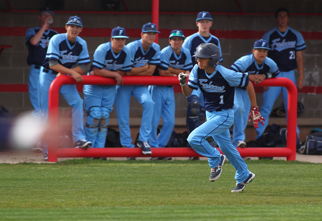Foothill's Daniel Ortiz runs for home to score the first run for the Falcons on Thursday. Foothill beat Las Vegas, 3-0. (Chase Stevens/Las Vegas Review-Journal)