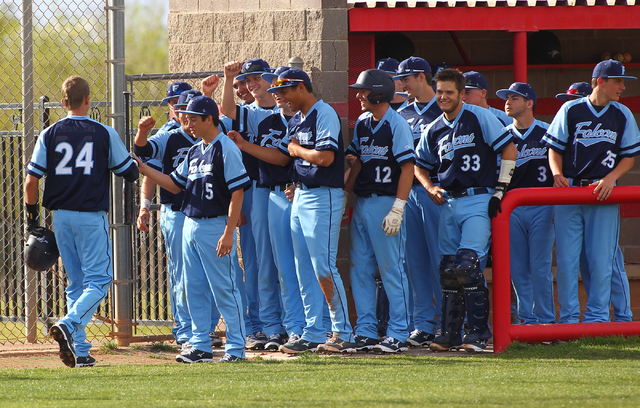 Foothill's Collin Dobrolecki (24) is congratulated by teammates after hitting a home run against Las Vegas High on Thursday. Foothill won the game, 3-0. (Chase Stevens/Las Vegas Review-Journal)