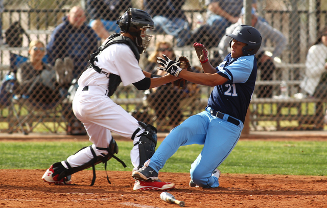 Las Vegas High's Ryan Freimuth tags out Foothill's Tyler Van Stone at home in the third inning on Thursday. Foothill won the game, 3-0. (Chase Stevens/Las Vegas Review-Journal)