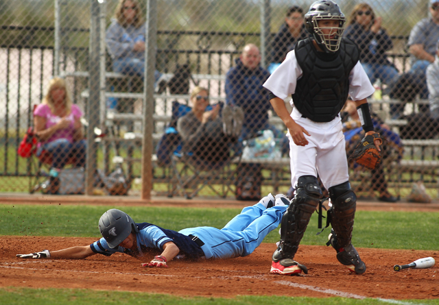 Foothill's Daniel Ortiz slides in to home to score against Las Vegas High on Thursday. Foothill won the game, 3-0. (Chase Stevens/Las Vegas Review-Journal)