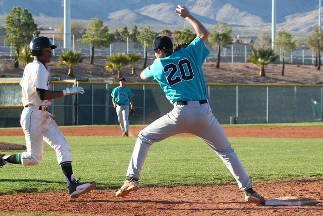 Silverado's Michael Camburn (20) catches the ball before tagging out Palo Verde's Will Hamilton at first base on Friday. Silverado won the game 11-8. (Chase Stevens/Las Vegas Review-Journal)