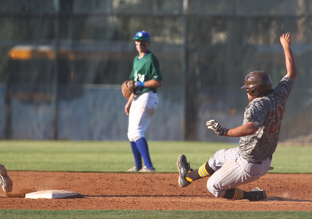Bonanza's Keith Werner (29) slides into second base against Green Valley on Friday. Werner and the Bengals earned a 9-5 win. (Chase Stevens/Las Vegas Review-Journal)