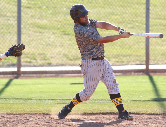 Bonanza's Keith Werner (29) swings to hit a home run against Green Valley on Friday. The Bengals earned a 9-5 road win. (Chase Stevens/Las Vegas Review-Journal)