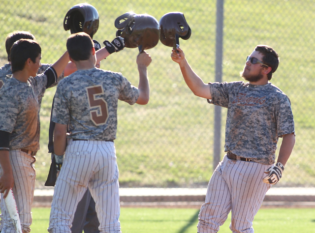 Bonanza's Keith Werner, right, celebrates with teammates, after hitting a home run against Green Valley on Friday. The Bengals won, 9-5. (Chase Stevens/Las Vegas Review-Journal)