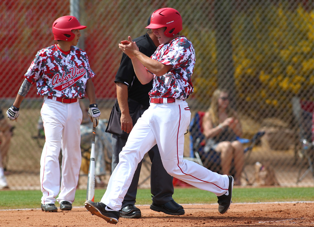 Arbor View's Sam Pastrone celebrates after scoring a run against Faith Lutheran on Saturday. Pastrone went the distance to get teh win and went 2-for-4Arbor View won 6-2. (Chase Stevens/Las Vegas  ...
