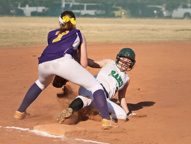 Rancho's Tori Hafen, right, slides safely into third base with an RBI triple as Durango's Cheyanne Haas awaits a throw. Rancho defeated Durango, 7-0. (Ronda Churchill/Las Vegas Review-Journal)