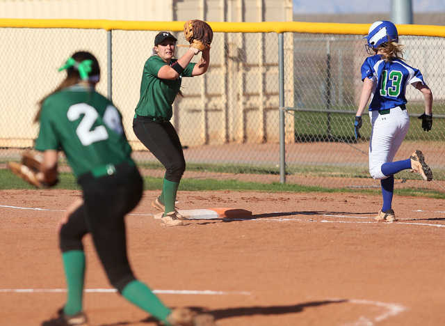 Palo Verde senior Rachael Turner, center, fields a throw to force Green Valley junior Tara Hilton at first base on  Tuesday. Palo Verde won, 5-0. (Ronda Churchill/Las Vegas Review-Journal)