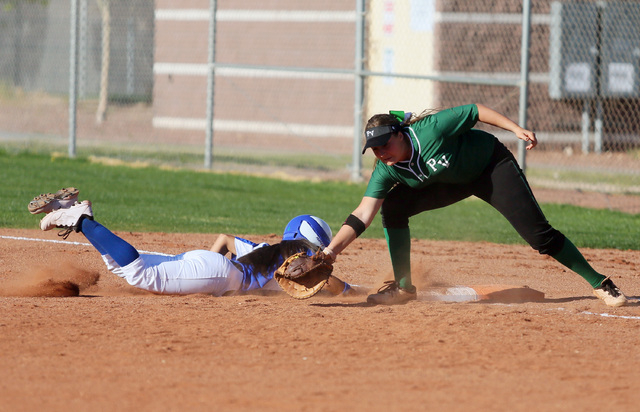 Green Valley senior Chelsea Perez, left, makes it back to first base safely past Palo Verde the tag of senior Rachael Turner on Tuesday. Palo Verde won, 5-0. (Ronda Churchill/Las Vegas Review-Journal)