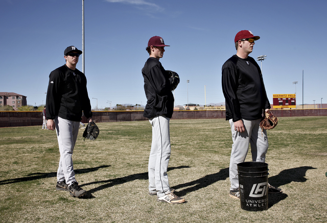 From left, Erich Uelmen, Jordan Dreibelbis and Brandon Johnson practice on Tuesday. The Faith Lutheran seniors all are committed to play in college. (John Locher/Las Vegas Review-Journal)