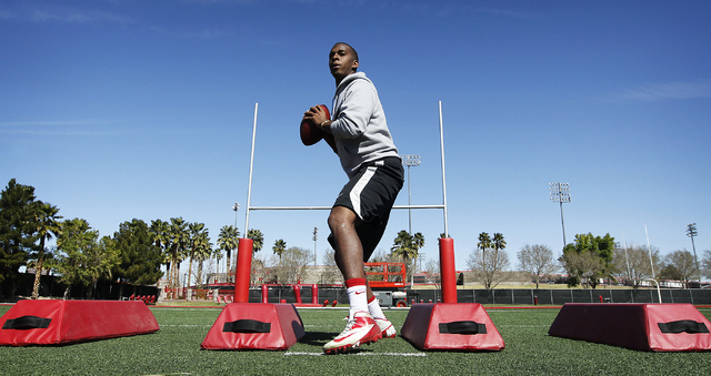 Former UNLV starting quarterback Caleb Herring works out in preparation for his pro day NFL audition at UNLV on Tuesday, March 11, 2014. (Jason Bean/Las Vegas Review-Journal)