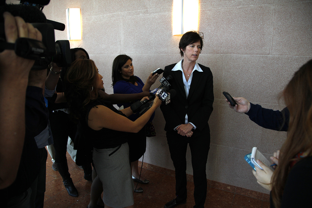 Christine Robinson, executive director of the Animal Foundation, speaks with members of the media outside Judge Kenneth C. Cory's courtroom at the Las Vegas Regional Justice Center on Tuesday. (Ju ...