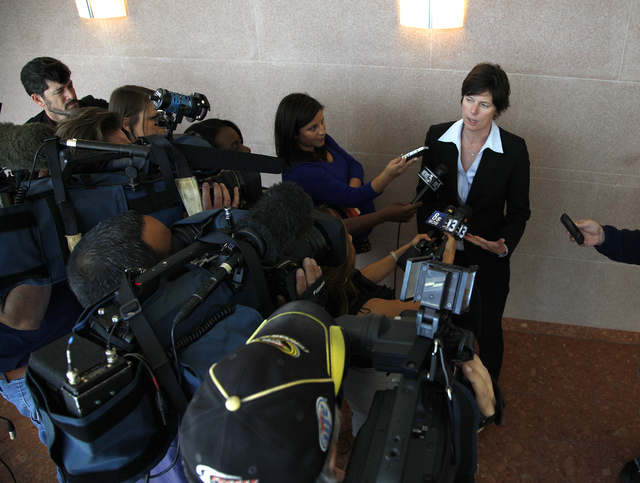 Christine Robinson, executive director of the Animal Foundation, speaks with members of the media outside Judge Kenneth C. Cory's courtroom at the  Las Vegas Regional Justice Center on Tuesday. (J ...