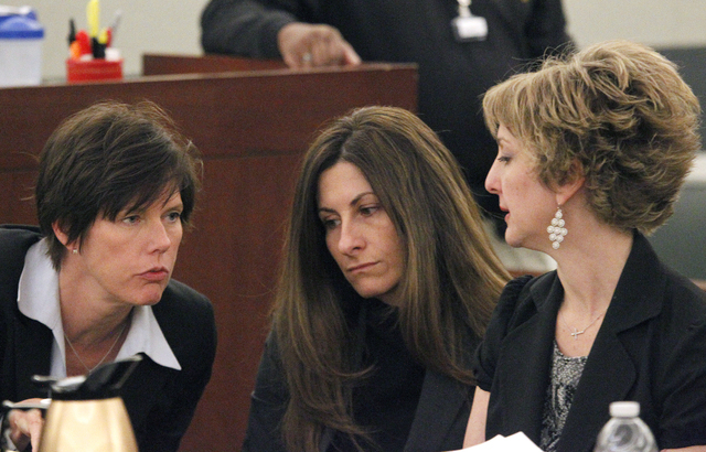 Lisa Zastrow, right, and Lyssa Anderson, center, confer with their client, Christine Robinson, in District Court Judge Kenneth C. Cory's courtroom on Tuesday. Zastrow was representing the Animal F ...