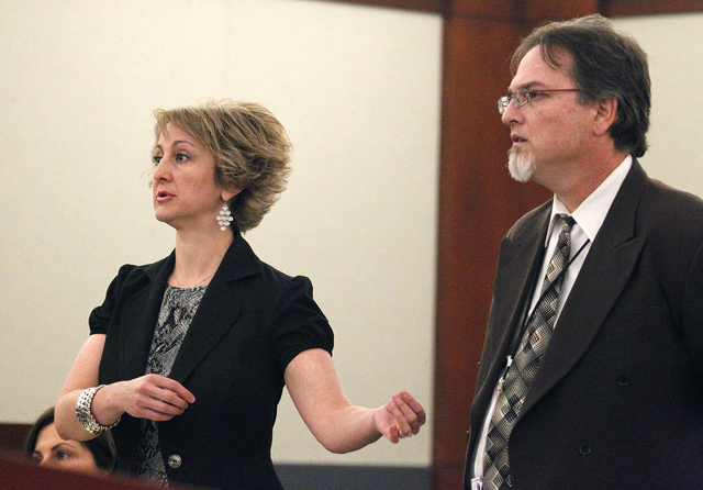 Lisa Zastrow, left, and Clark County Deputy District Attorney Steven Sweikert argue in District Court Judge Kenneth C. Cory's courtroom on Tuesday. Zastrow was representing the Animal Foundation i ...