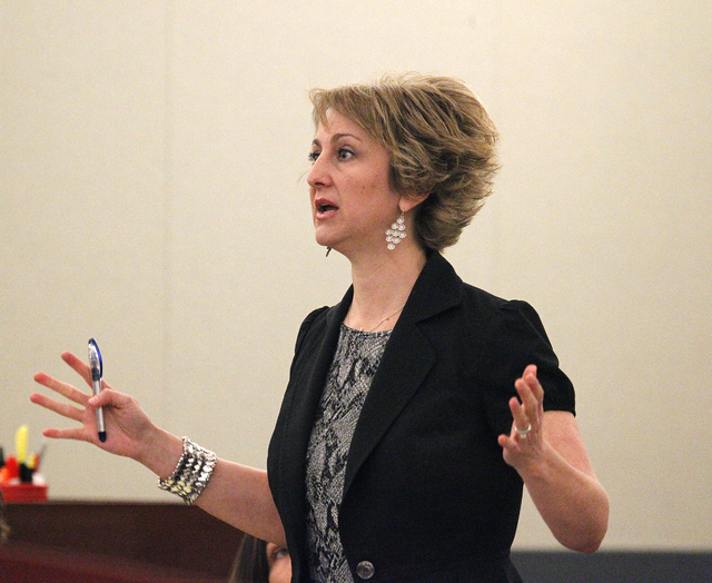 Lisa Zastrow argues in District Court Judge Kenneth C. Cory's courtroom Tuesday. Zastrow was representing the Animal Foundation in a dispute over the 27 dogs rescued from the fire at the Prince an ...
